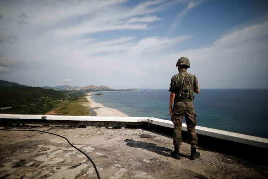 A South Korean soldier stands guard at the Unification Observatory, just south of the Demilitarized Zone separating the two Koreas in Goseong, South Korea, on Aug 20, 2018.