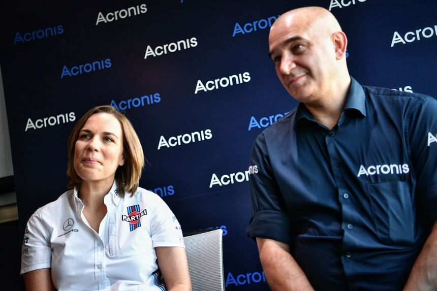 Claire Williams (left), deputy team principal of the Williams Formula One racing team, and Serguei Beloussov, CEO of Acronis.
