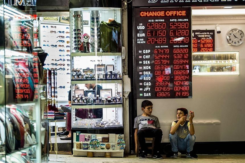A currency exchange office in Istanbul, Turkey. The Turkish lira has slumped against the greenback amid rising tensions between the US and Turkey. While the crisis in Turkey began as a home-grown problem, the stress has spilled over to other markets.
