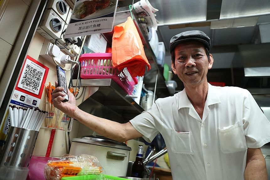 Mr Lim Heng, who sells hor fun at Old Airport Road Food Centre, says he sees the need to go cashless if that is the future. Nets will now be the single touchpoint for about 20 payment schemes at hawker centres, canteens and coffee shops.