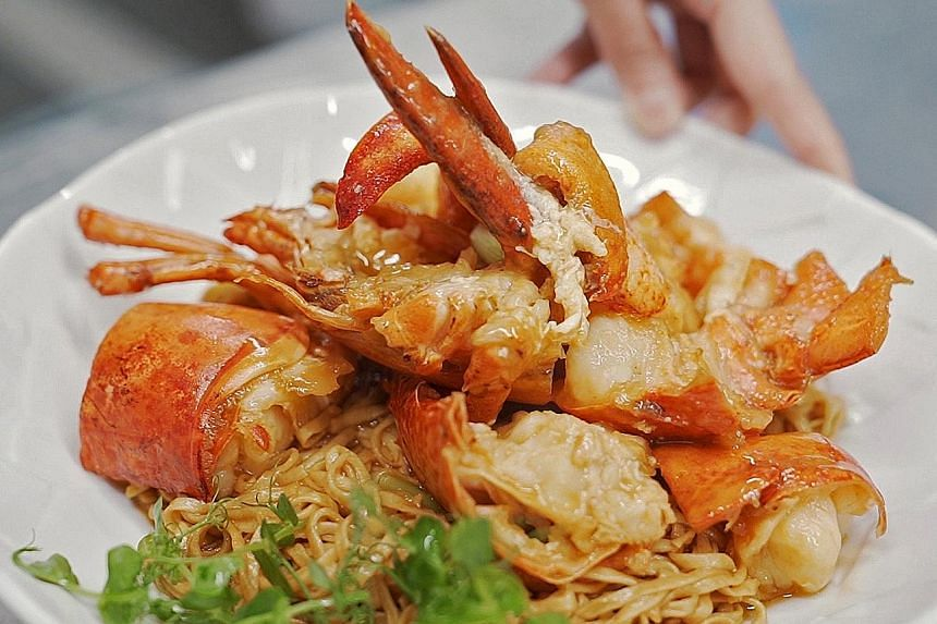 One of the signature dishes of chef Yong Bing Ngen (above) of Majestic Restaurant is lobster noodles (left).