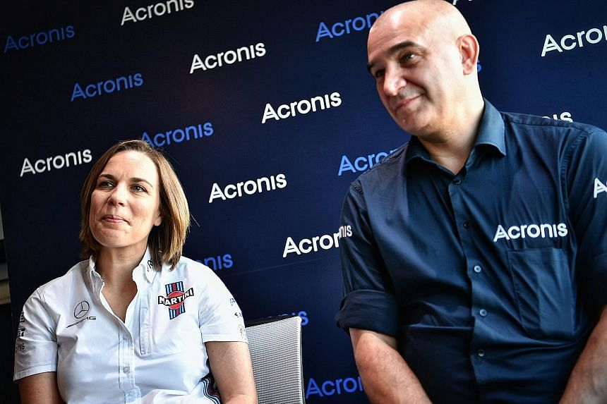 Claire Williams, deputy team principal of Williams, with Serguei Beloussov, CEO of Acronis, the F1 team's strategic technology partner. Williams, who have nine constructors' and seven drivers' titles, are currently last of the 10 teams.