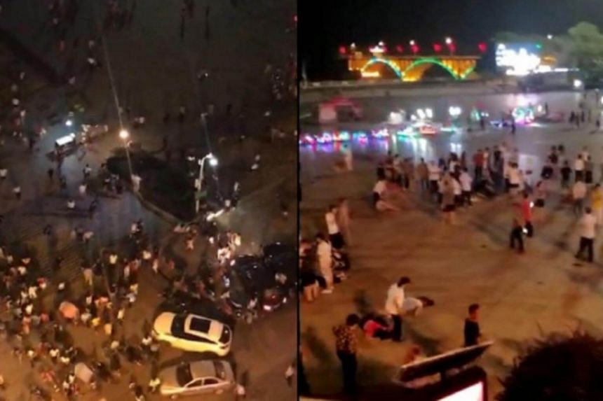 People seeking for help as wounded and dead bodies lie in the square after a man drove a vehicle into a crowded pedestrian square.
