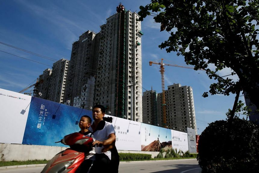 Debt-laden developers are offering free luxury cars and hefty discounts to lure buyers while China's lid on home prices makes it harder to generate swift cash from sales.
