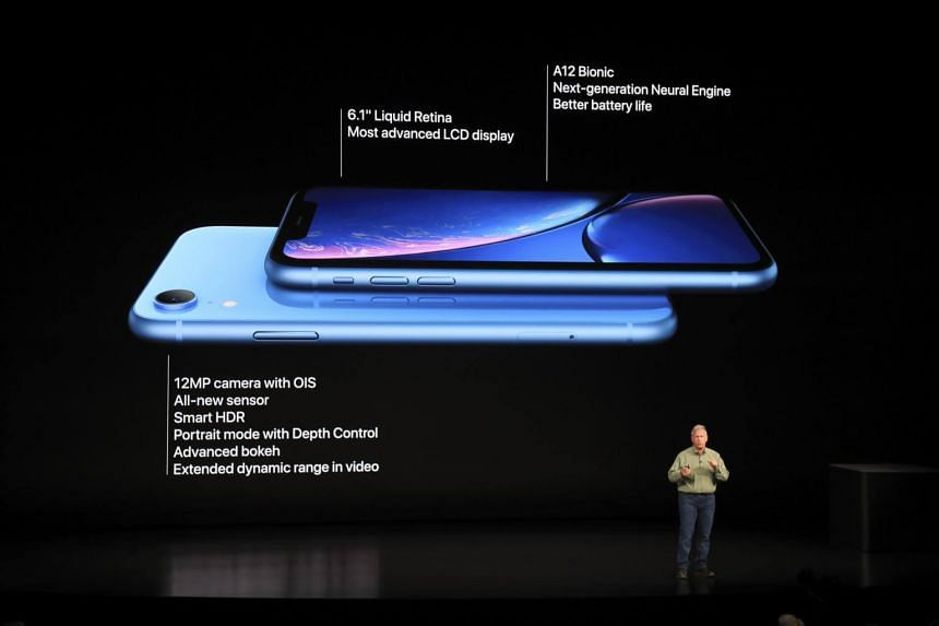 Apple's senior vice president for marketing, Philip Schiller, showing off the new iPhone Xs and iPhoneXs Max at a new product launch event.