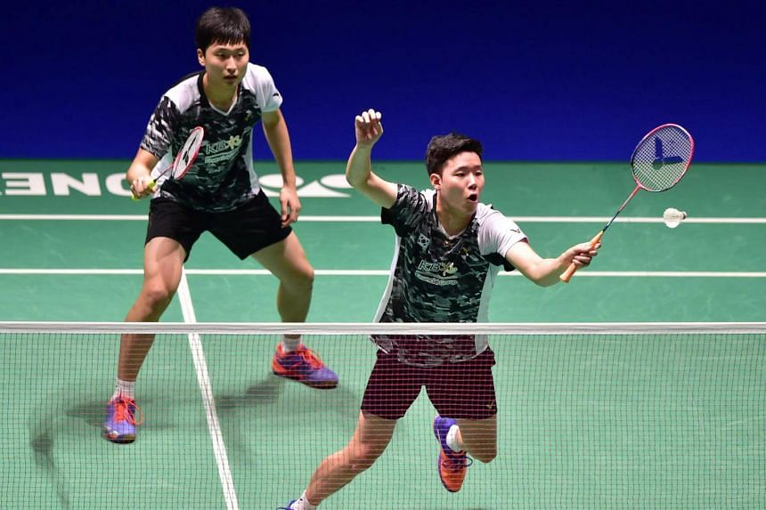 South Korea's Seo Seung-jae (right) and Kim Won-ho during their men's doubles first round match at the Japan Open badminton championships.
