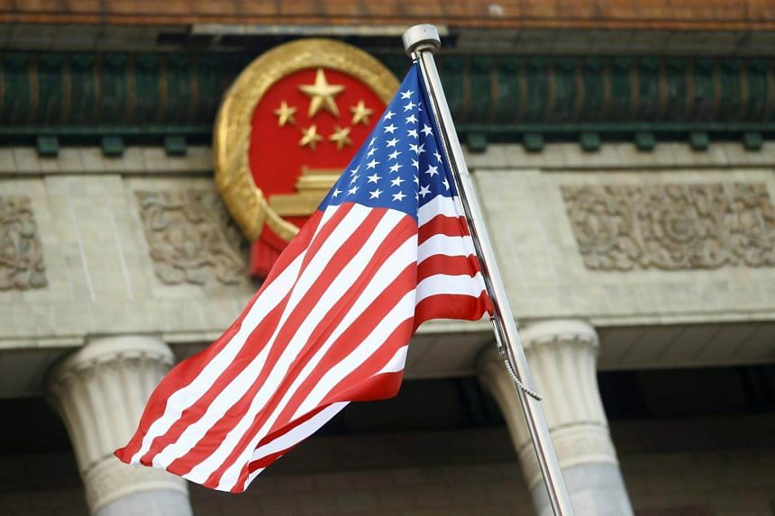 File photo showing the US flag being flown in in Beijing, China.