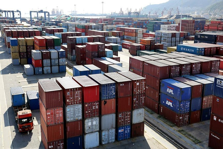 Shipping containers are seen at a port in Lianyungang, Jiangsu province, China, on Sept 8, 2018.