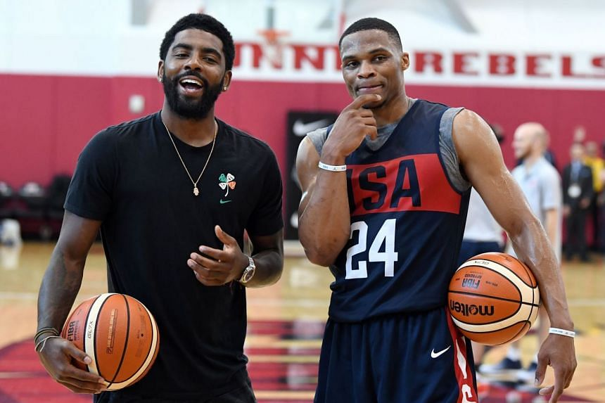 Westbrook (right) and Kyrie Irving joke around during a July 2018 practice session in Las Vegas, Nevada.