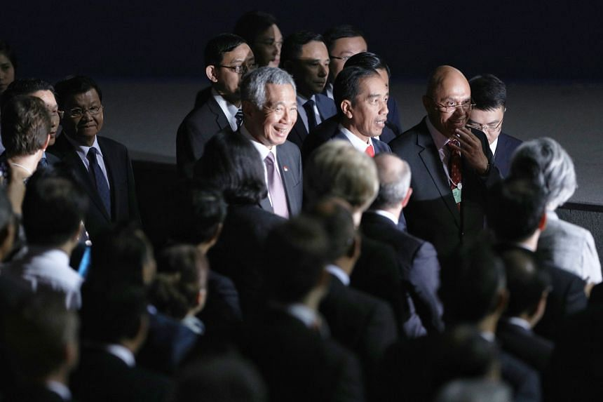 Prime Minister Lee Hsien Loong and Indonesian President Joko Widodo arriving at the National Convention Centre for the opening of the World Economic Forum in Hanoi yesterday. At the forum, PM Lee said further economic integration in Asean is an impor