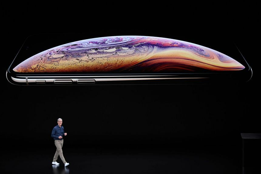 Apple's CEO Tim Cook announcing the new iPhone XS during a special event at Steve Jobs Theatre in Apple Park.