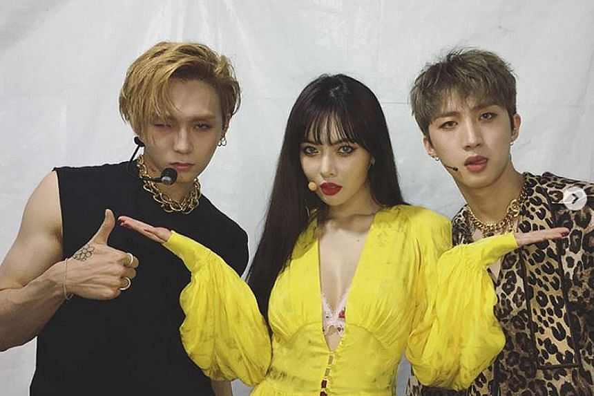 E'Dawn and HyunA with Hui (right), their fellow member from K-pop trio Triple H.