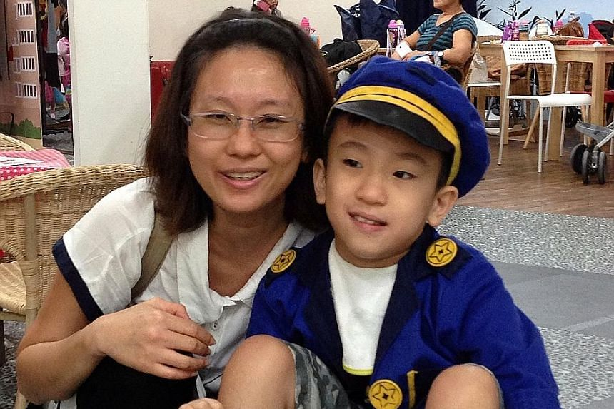 Madam Serene Poh with her son, Jayden Tan, 12, who was diagnosed with Pura syndrome by KKH doctors using the gene-sequencing test.