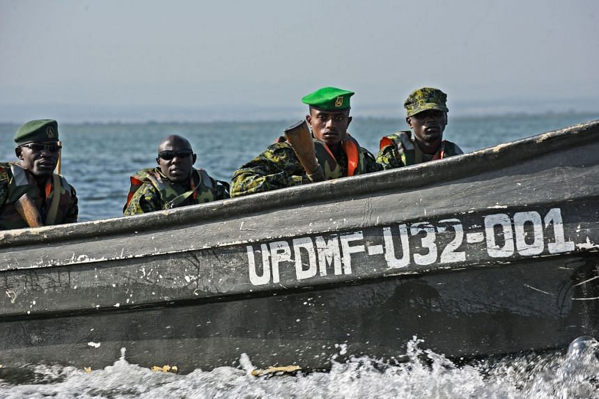 Members of the Uganda People's Defence Marine Force patrol in a boat on the lake Edward, in Rwenshama, in the Rukungiri District, on Aug 13, 2018.