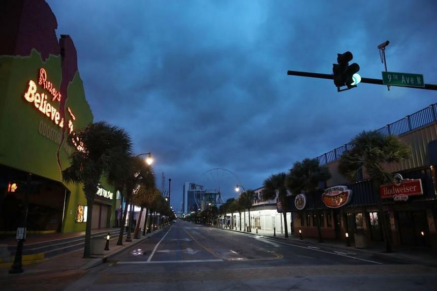 Clouds are seen over a deserted Ocean blvd as the force of Hurricane Florence is felt on Sept 14, 2018 in Myrtle Beach, United States.