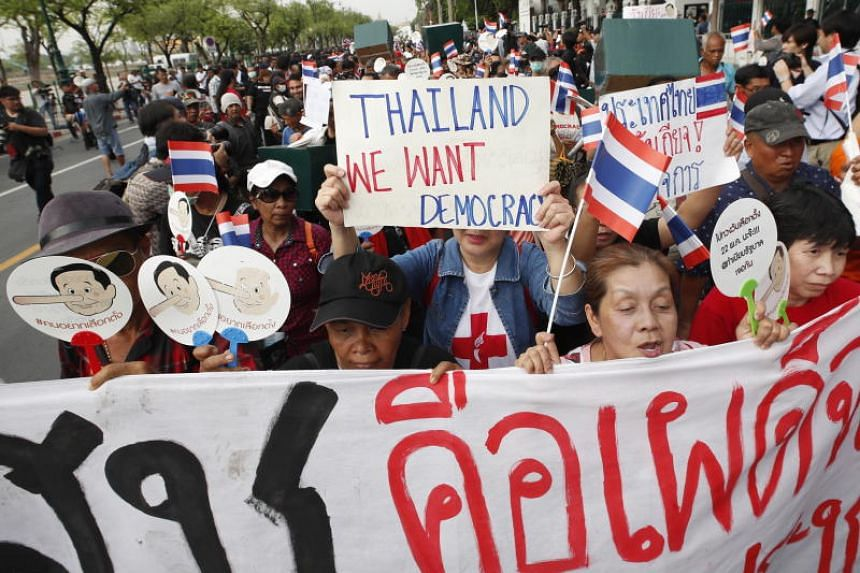 Thai pro-democracy protesters shout slogans as they march toward Government House during a rally in Bangkok, Thailand, on May 22, 2018.