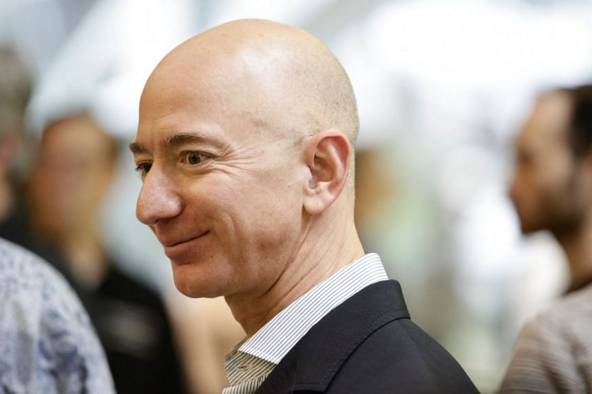 Bezos (above) has a fortune now estimated at some US$163 billion (S$220 billion).