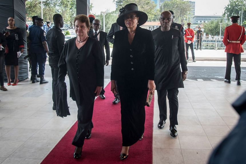 Widow of Nelson Mandela and former first lady of South Africa, Graca Machel (centre), arrives to attend the funeral.