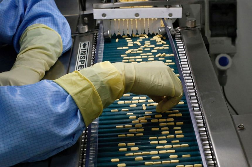 File photo of an employee inspecting tablets as they move along the production line at a pharmaceutical plant of Lupin, in Verna, in the western state of Goa, India, on June 9, 2017.