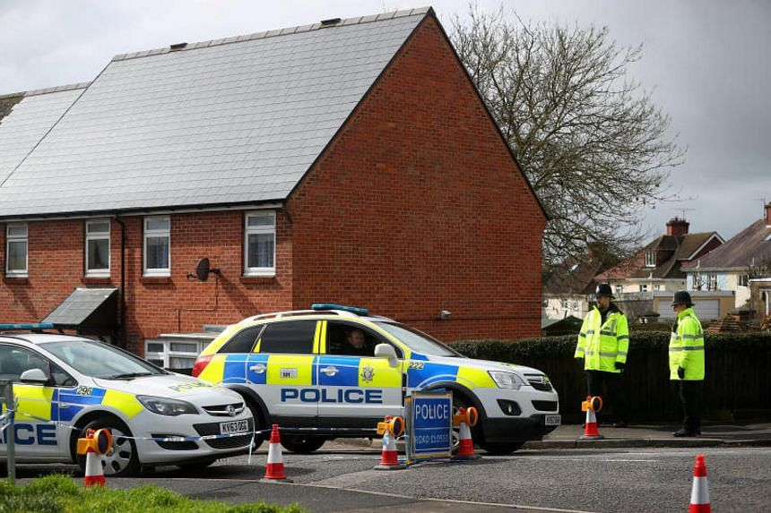 File photo of police officers guarding the cordoned off area around the home of former Russian intelligence officer Sergei Skripal in Salisbury, Britain, on April 3, 2018.