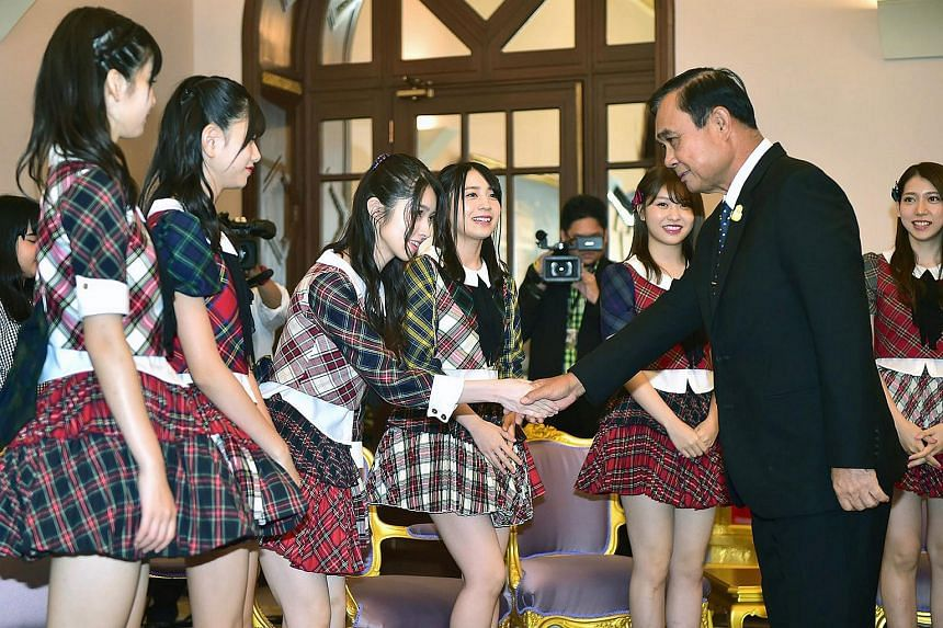 Thai PM Prayut Chan-o-cha (second, right) meeting with members of Japanese pop group AKB48, before a meeting at the Government House in Bangkok, Thailand, on Sept 13, 2018.