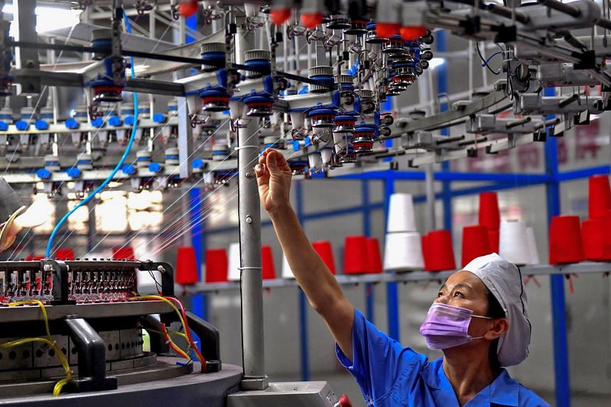 A textile factory in Shangqiu, in China's central Henan province. So far, the US and China have imposed tariffs on US$50 billion (S$68.6 billion) worth of each other's goods.