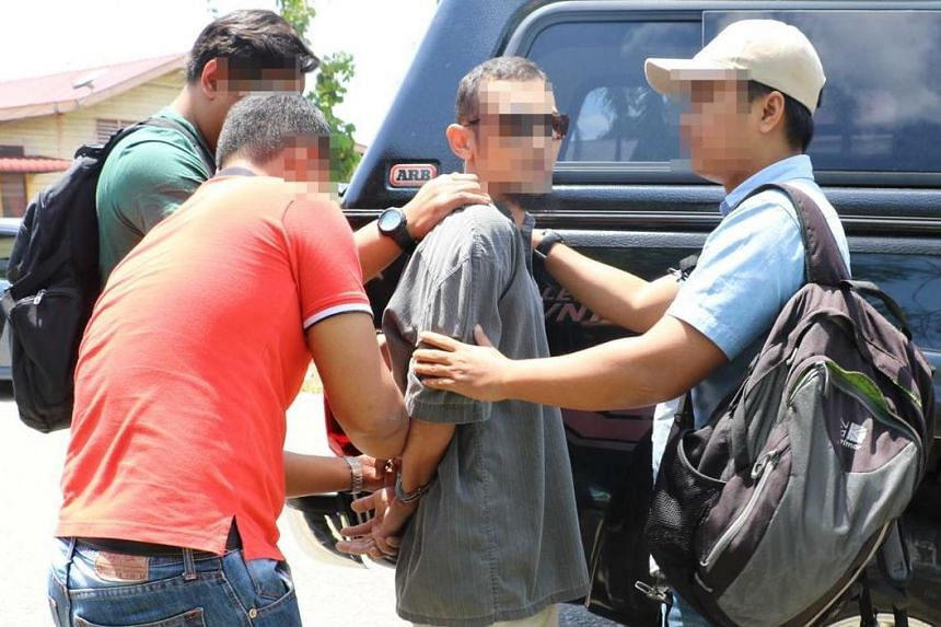 Malaysia's anti-terrorism division officers nabbing a suspected militant.