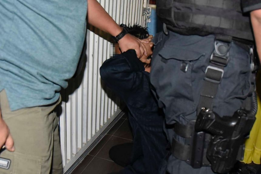A suspected militant being nabbed.