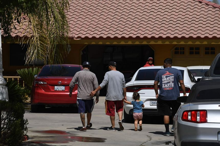 Victims' relatives arrive at the house on Breckinridge Road that was a scene of the shooting in Bakersfield.