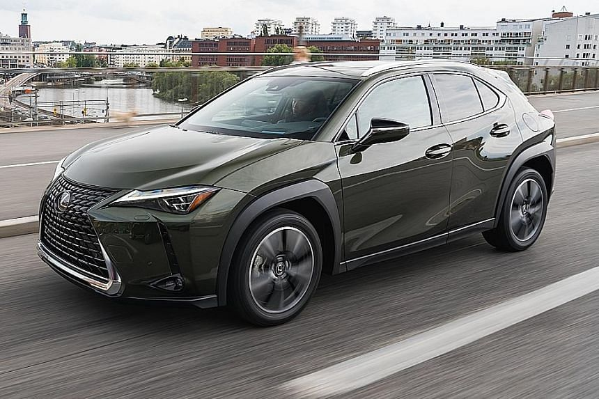 The interior of the Lexus UX200 includes a dash top lined with a surface reminiscent of Japanese washi paper, a large infotainment screen paired with a user-friendly touchpad, and hi-fi controls recessed in the beak of the centre armrest. The Lexus U