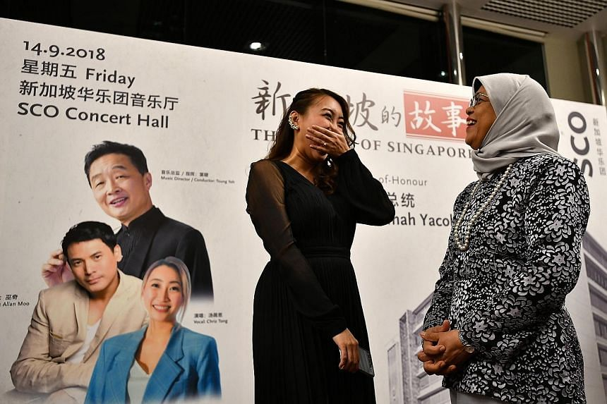 """President Halimah Yacob with vocalist Chriz Tong, who sang at Lianhe Zaobao's 95th anniversary concert (left) yesterday. Titled """"The Story of Singapore"""", the two-day concert, which ends today, is a collaboration between Singapore Press Holdings and t"""