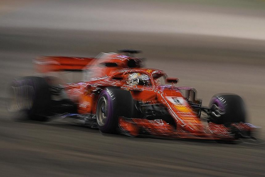 Sebastian Vettel of Ferrari during last night's second practice session for the Singapore Grand Prix. He completed only 11 laps after his car bounced off a wall, breaking a hydraulic pipe and damaging his right rear and front wheels. Team-mate Kimi R