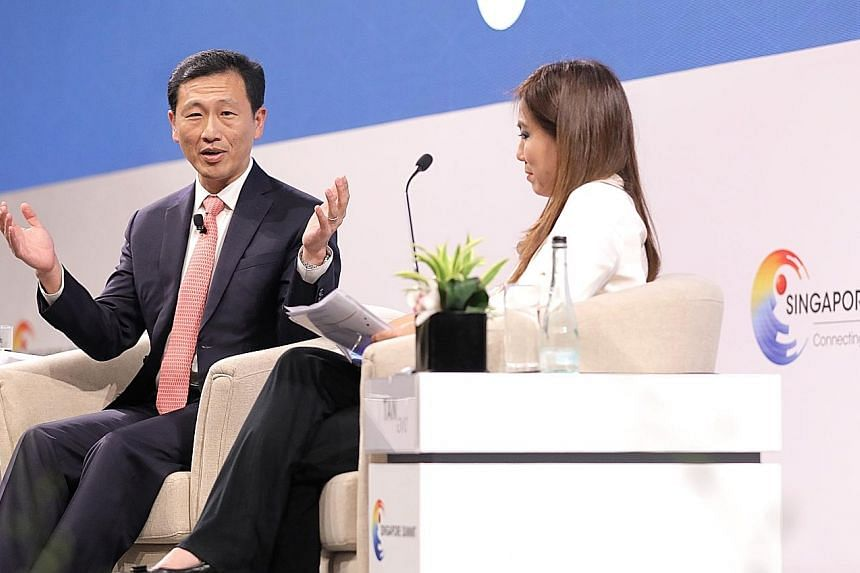 Education Minister Ong Ye Kung with moderator Tan Su Shan, managing director and group head of consumer banking and wealth management at DBS Bank, at a dialogue at the Singapore Summit at Shangri-La Hotel yesterday.