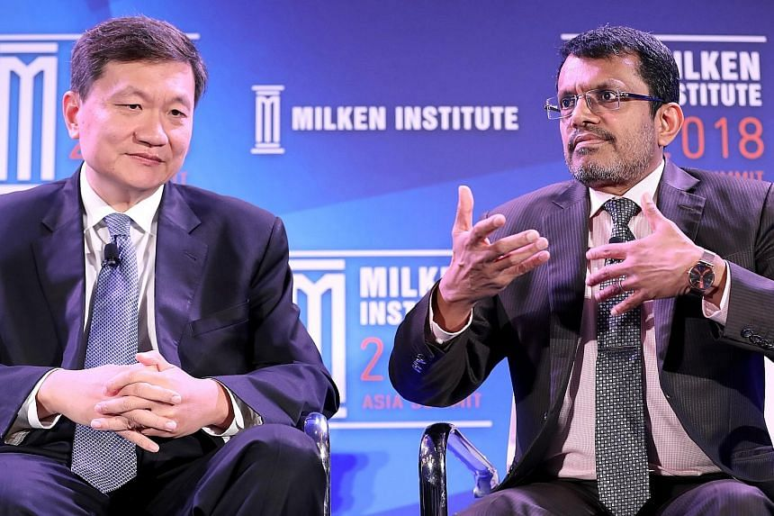 Monetary Authority of Singapore managing director Ravi Menon and CreditEase founder and CEO Tang Ning at the Milken Institute's Asia Summit, which wrapped up yesterday. A two-day Singapore Summit, where Asia's leaders discuss regional and global chal