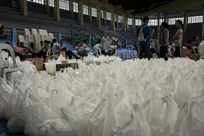The Philippines is bracing itself for a super storm today. Bags of relief supplies were in place at a makeshift disaster relief operations centre yesterday in Tuguegarao, in Cagayan province, ahead of Super Typhoon Mangkhut's arrival. The authorities