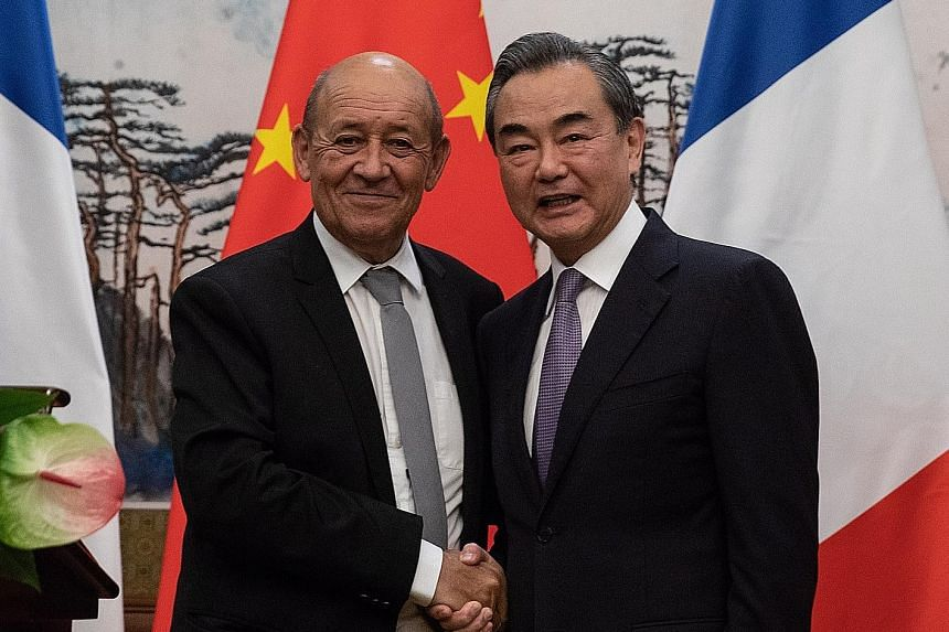Visiting French Foreign Minister Jean-Yves Le Drian with his Chinese counterpart, State Councillor Wang Yi, at their press conference following a meeting at the Diaoyutai State Guesthouse in Beijing on Thursday.