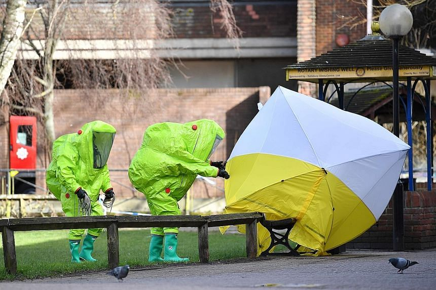 Mr Sergei Skripal (far left), a former Russian intelligence officer living in Britain, and his daughter Yulia were poisoned with a military-grade nerve agent. The pair were found slumped unconscious on a park bench (above) in the city of Salisbury in