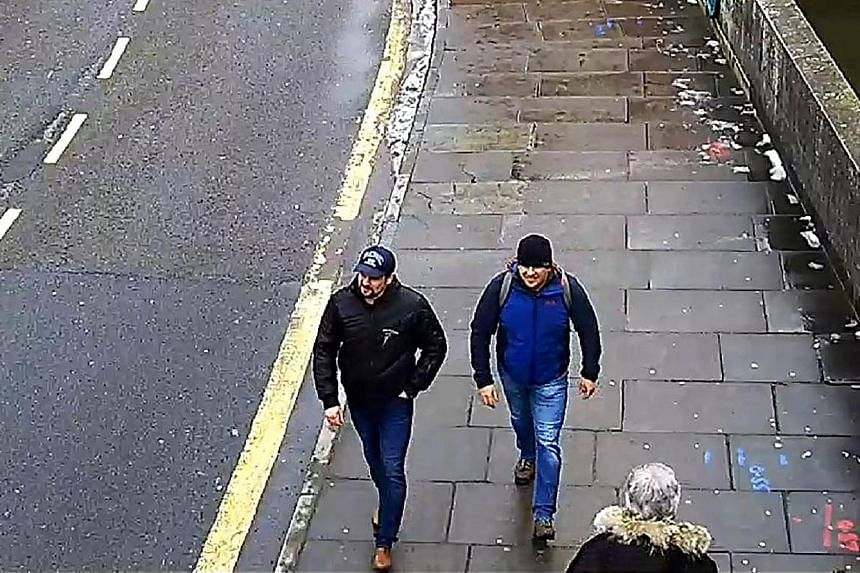 Ruslan Boshirov (top) and Alexander Petrov (above) are said to be the men in an image (right) released by the Metropolitan Police of Britain.