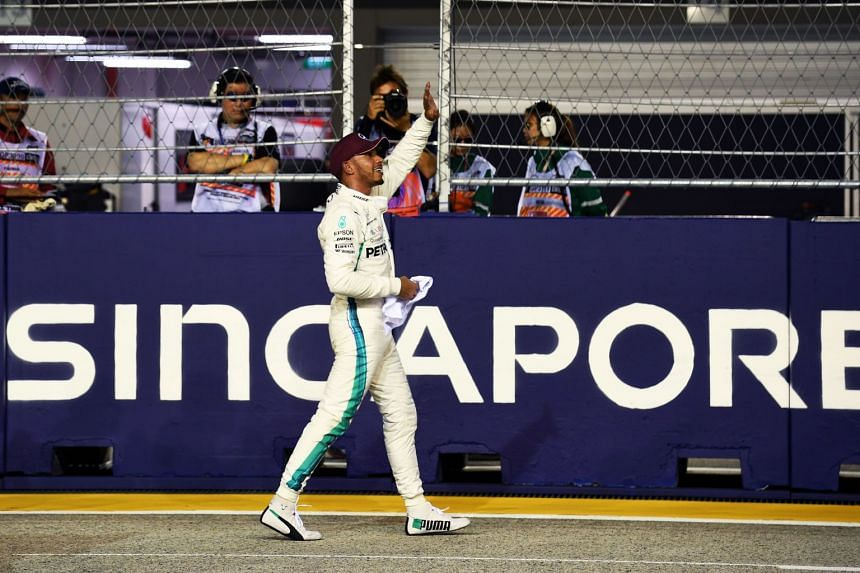 Lewis Hamilton reacts after winning the pole position during the qualifying session ahead of the Singapore Formula One Grand Prix at the Marina Bay Street Circuit on September 15, 2018.