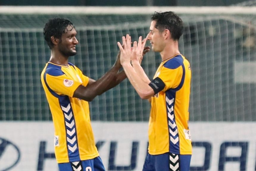 Tampines Rovers' Madhu Mohana (from left) and Daniel Bennett congratulate each other after their match against Balestier Khalsa in the Singapore Premier League, on Sept 15, 2018.