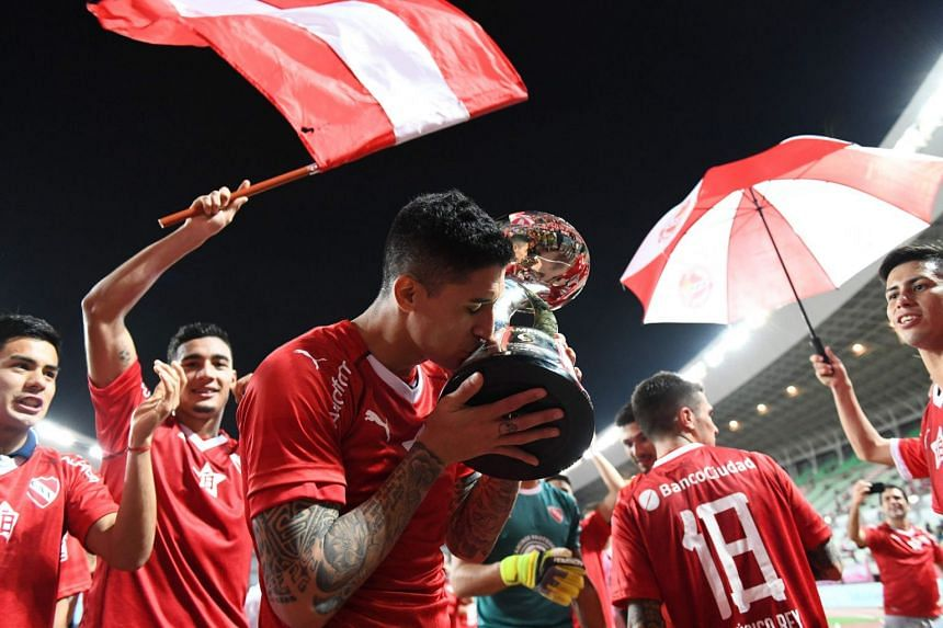 Independiente players celebrate victory against Cerezo Osaka of Japan in Osaka on Aug 8, 2018.