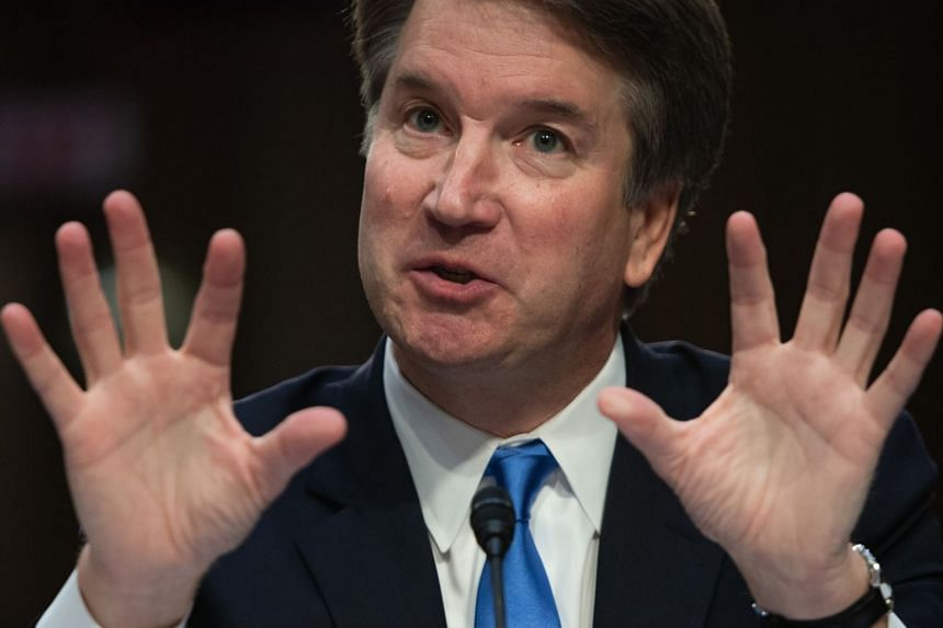 Kavanaugh (above) rejected the woman's claim that he tried to force himself on her during a party while in high school.