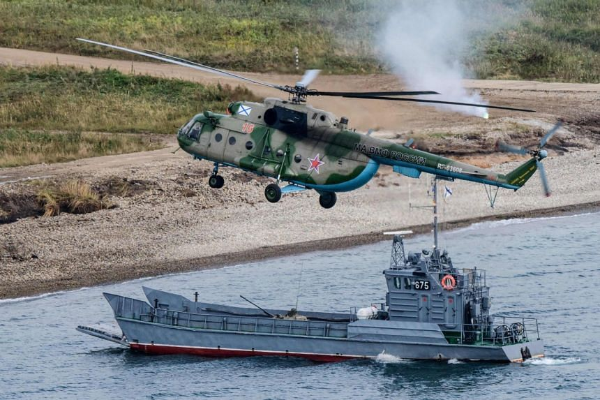 Russian military forces perform a landing during the Vostok-2018 (East-2018) military drills at Klerka training ground on the Sea of Japan coast, on Sept 15, 2018.