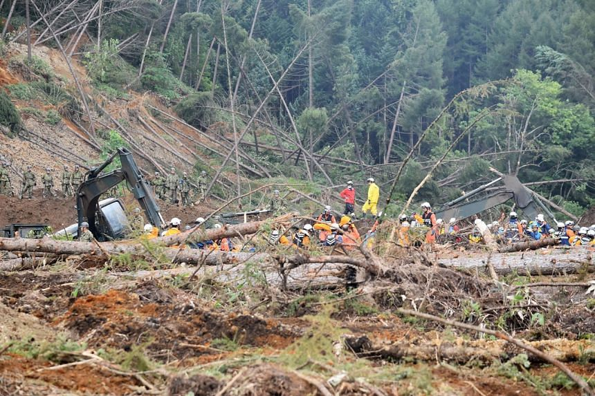 Officials searching for missing people in the city of Atsuma on Sept 9, 2018, after a 6.6-magnitude earthquake hit the northern Japanese island of Hokkaido.