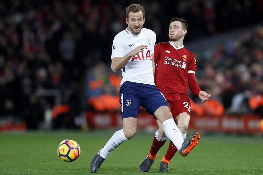 Tottenham's Harry Kane (left) in action with Liverpool's Andrew Robertson during a football match on Feb 4, 2018.