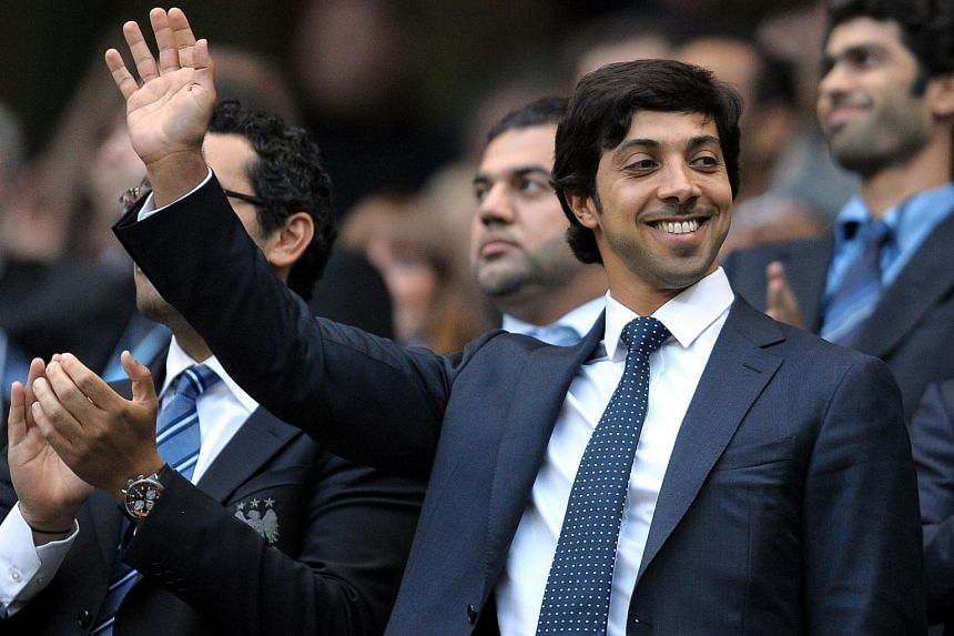 Manchester city owner Sheikh Mansour Zayed Al Nahyan waves during an English Premier League football match against Liverpool.