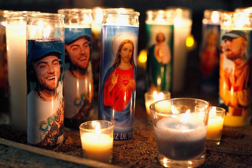 Candles form a memorial to late rapper Mac Miller in Los Angeles, California.