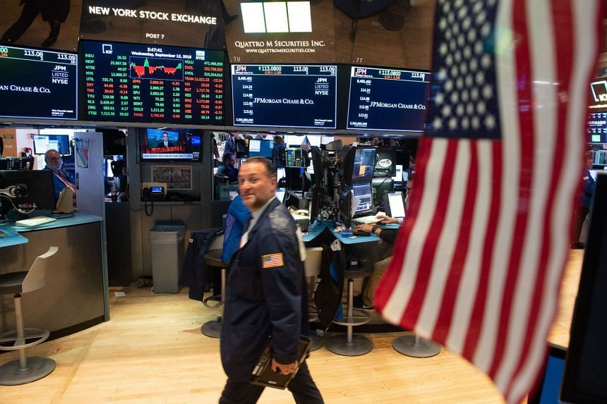 Traders work on the floor of the New York Stock Exchange on Sept 12, 2018.