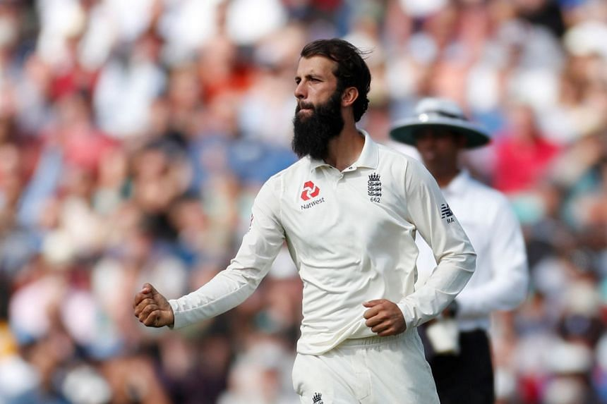 England's Moeen Ali celebrates the wicket of India's Hanuma Vihari during the Fifth Test, Sept 9, 2018.
