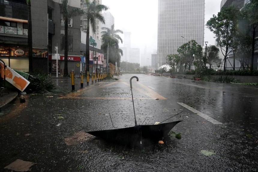 An umbrella is seen on a road as Typhoon Mangkhut makes landfall in China's Guangdong province, in Shenzhen, on Sept 16, 2018.